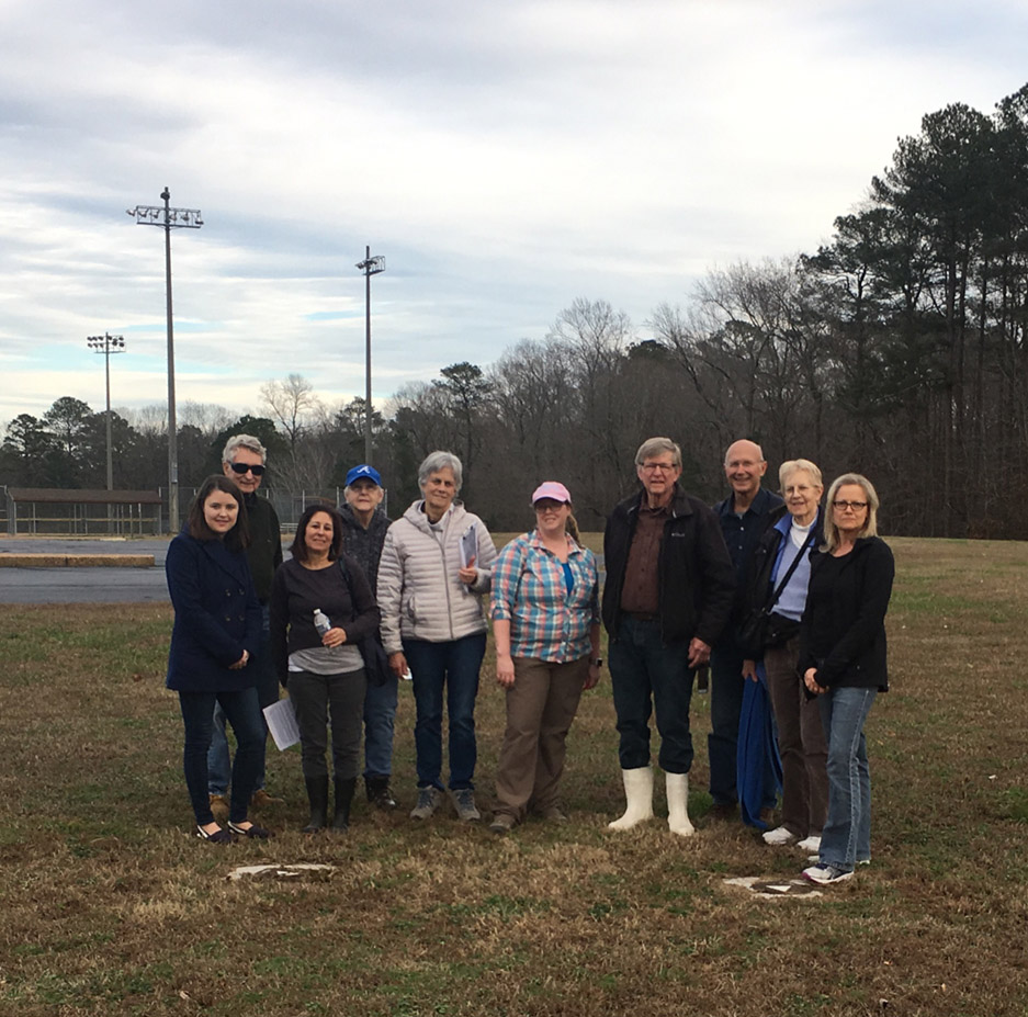 Image of water group members at ball field.